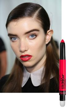 """""""It will be a nice little surprise in the show,"""" said makeup artist Yadim of sending a handful of models down the runway with tomato-red pouts inspired by Peter Lindbergh's iconic portraits of '90s supermodels. """"It's power dressing and the power woman done in a fresh and modern way."""" For a similar look, try Maybelline New York Lip Studio Color Blur Matte Pencil in Cherry Cherry Bang Bang ($9).   - ELLE.com"""