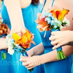 Orange and blue bouquet. Mini Calla lilly wit pincusion proteas, delpiniums, spray roses and willow loops