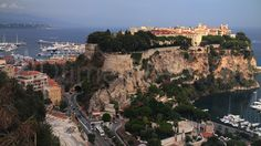 """Monaco-Ville, the old city on a rocky promontory extending into the Mediterranean, known as the Rock of Monaco, or simply """"The Rock"""";"""