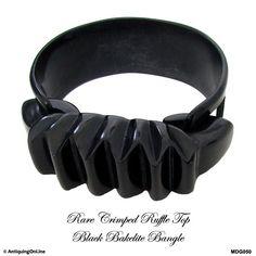 Rare #Black #Bakelite Ruffle Bow Top Bracelet, Art #Deco Bakelite #Bracelet by AntiquingOnLine at https://www.etsy.com/listing/263344632/rare-black-bakelite-crimped-ruffle-bow