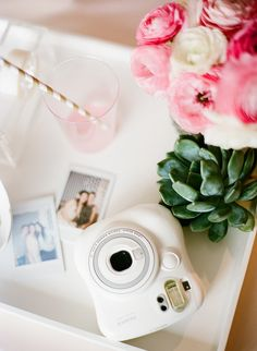 Pretty little details Fuji Instax and Florals by Avery Green Honolulu for Chair Cover Express.  Photo by Ashley Goodwin Photography, Contax 645