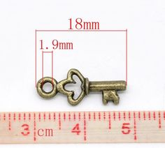lot de 10 breloques clé couleur bronze : Clefs par conte-a-mains-bontricotetbois
