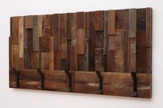 Hey, I found this really awesome Etsy listing at http://www.etsy.com/listing/163758745/reclaimed-wood-art-coat-rack-36x185x4