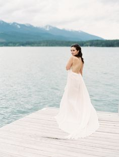 Chic Leanne Marshall wedding dress: http://www.stylemepretty.com/little-black-book-blog/2016/11/21/elegant-mountain-vineyard-wedding-inspiration/ Photography: Rebecca Hollis - http://www.rebeccahollisphotography.com/