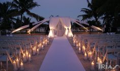 Loved this wedding we did with candles along the aisle of a gorgeous beach ceremony.  And check out that alter!