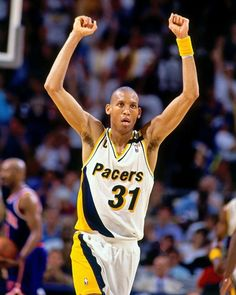 Reggie Miller celebrates on the way down the court after a big basket against the New York Knicks.