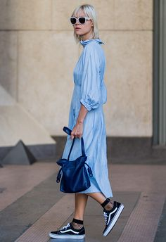 Linda tol wearing blue shirt dress with fishnet ankle socks and trainers