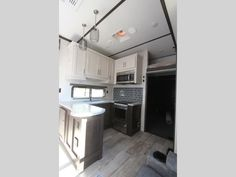 Keystone Raptor toy hauler 423 highlights: Outdoor Kitchen Separate Garage Loft Exterior TV Master Suite With this Raptor toy hauler, you will. Raptor Toys, Fifth Wheel Toy Haulers, Ocala Florida, Convection Cooking, Garage Loft, Electric Awning, Keystone Rv, French Door Refrigerator, Entry Doors