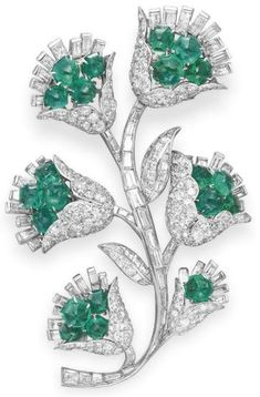 Retro emerald and diamond brooch, Van Cleef and Arpels, circa 1966. Via Diamonds in the Library.