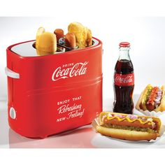 The Nostalgia HDT600COKE Coca-Cola Pop-Up Hot Dog Toaster will be the envy of any Coke collector. The large hot dog cage fits two regular-size or extra-plump hot dogs. Adjust the heat setting to cook