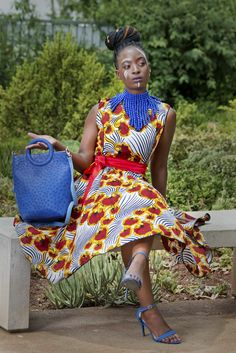 No shrinking violet here! it's bold and beautiful with a burst of bright colours. The Red Zebra dress is Tea-length and is paired with a bold blue neckpiece and leather bag. Funky Design, Bright Colours, Tea Length, New Dress, Leather Bag, African, Pairs, Red, Blue