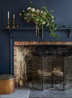 10 Historic Homes for Modern Creative Families (Design*Sponge) Navy paint and exposed brick -- beautiful. 10 Historic Homes for Modern Creative Families Paint Fireplace, Small Fireplace, Fireplace Screens, Fireplace Design, Fireplace Ideas, Fireplace Guard, Brick Fireplace Paint, Exposed Brick Fireplaces, Fireplace Feature Wall
