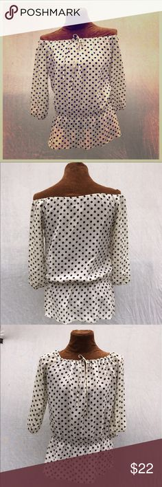 Vintage off-shoulder blouse Off-white and navy polka-dot peasant blouse. Vintage- absolutely gorgeous! Elasticized neckline allows for styling on-or off-shoulder. Elasticized waist. Small snag in fabric... Don't let that detract from it's beauty. It is vintage after all. Size small. Measurements upon request. 🚫NO TRADES Vintage Tops Blouses