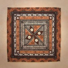 New square Masi with intricate detailing.