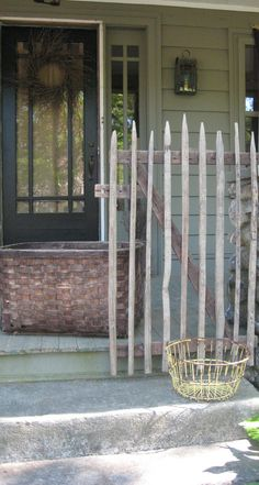 Front porch-fence made by the Amish, old basket and old clam bucket from Cape Cod