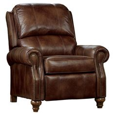 Curl up with a comfy throw and your latest read on this handsome recliner, showcasing rich brown upholstery, turned feet, and an artful nailhead trim.