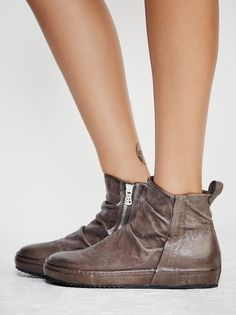 Russell Sneaker   Ultra cool high-top leather sneaker featuring a slouchy design and a disguised sole. Back pull tab and side zipper closure for an easy on-off.