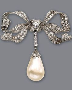 A diamond and pearl brooch-pendant of bow motif, set throughout with old-European and table-cut diamonds, suspending a natural drop-shaped pearl, measuring 13.96 x 10.46mm; estimated total diamond weight: 3.00 carats; mounted in platinum; length: 4 1/4in.