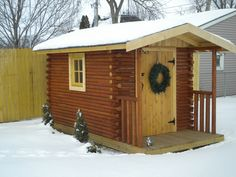 A shed built by my Pop using landscape timbers to look like a log cabin. Sweet!