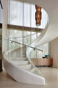 This white sculptural spiral staircase entices you upstairs in this home. This white sculptural spiral staircase entices you upstairs in this home. Luxury Staircase, Staircase Architecture, Curved Staircase, Architecture Design, Staircase Ideas, Spiral Staircases, Contemporary Architecture, Railing Ideas, Grand Staircase