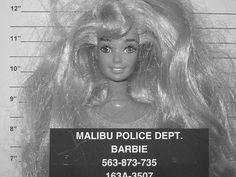 I suspected as much. Didn't like her as a child.   LOL Love the Barbie mug shot!
