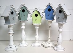 Great use of candle sticks and birdhouses.  Spray and shabby chic the candle sticks, and hot glue the birdhouse on top = adorable!
