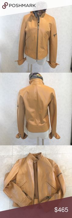 """Tombolini Italian Leather Bomber NWOT 40 Butterscotch leather bomber jacket from Tombolini makes the finest  of fashions for women.  Designed &'made in Italy with double zip front and  snap mandarin collar, zippers on leather lined cuffs which can be turned back for a more casual look. Slash pockets & finished waistband so no unsightly elastic. Lays flat, looks neat. Fully lined.  Standout color is gorgeous for spring. Never worn. Size equivalent to 4. 26"""" sleeve, 16"""" across back, 20.5""""…"""