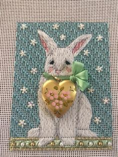 needlepoint rabbit with floral heart locket embellishment, designer unknown