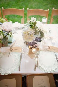 Use doilies for place mats AND put tags on napkins as place cards. Also, make napkins out of rustic/vintage fabric and tie with twine.