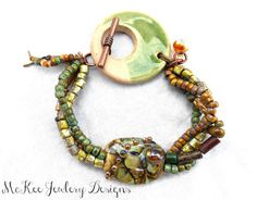 Green. Ceramic, Czech glass and metal multi strand knotted bracelet. Andria McKee at McKee Jewelry Designs