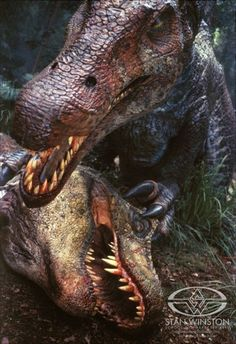 JP III's Spino lords over the defeated T-rex. Jurassic Park fans around the world mourn.