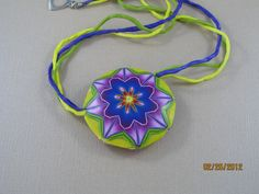 Polymer clay kaleidoscope pendant made from cane I made at Carol Simmons workshop.