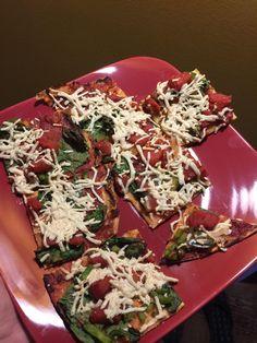 Made vegan pizza last night. Cauliflower crust spinach Roma tomatoes and daiya vegan mozzarella cheese.