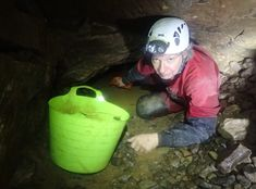 GB cave - bailing the duck between ladder dig climb and Bat passage.  South Wales Caving Club - blog: How to have Mendip caves [almost] all to yourself?