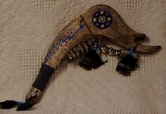 Native American Weapons   Navaho ceremonial Jaw bone---This Native American Indian Artifact is an authentic Navajo made Jawbone, initially it was used as a weapon and as an utensil on the cleaning of the hunt, it has raw hide with painted designs, leather, beads, fur and feathers.