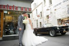 Mustangs in Black 1966 Shelby GT350 Convertible Ford Mustang outside Pellegrinis Espresso Bar in Melbourne for Bill and Maria's wedding shoot. Photo by Alex Pavlou Photography.