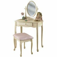 """Off-white child's vanity with a scalloped apron and oval mirror. Includes bench with pastel pink upholstery.       Product: Youth vanity, mirror and bench    Construction Material: Engineered wood, wood and rubberwood    Color: Off-white and pastel pink    Features:Queen Anne legsUpholstered bench    Dimensions:Vanity and mirror: 51"""" H x 28"""" W x 15.875"""" D Bench: 17"""" H x 18.5"""" W x 14.5"""" D    Note: Some assembly required"""