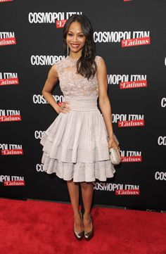 Zoe Saldana attends the Cosmopolitan for Latina's Premiere Issue Party in a Elie Saab lavender cocktail dress with sheer embellished neckline and tiered skirt detail from the Fall 2009 Haute Couture collection.