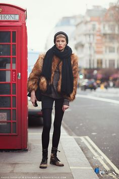 Ani Alitalo in a red faux fur coat, black denim, cutoff shorts, and distressed combat boots.