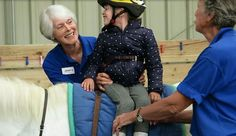Gabriela Machado-Hayden has hypermobile joints, muscle weakness and is blind. Two years ago the 6 yr old was unable to sit unsupported on her mother's knee.  Since January, however, Gabriela has had weekly hippotherapy sessions with the group. By July she was able to stand unsupported for over three minutes and walk holding an adult's hand.