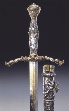Electoral Sword with scabbard, knife and awl  Materials and technology: double-edged blade, hollow ground, impact brand etched in the deep gold, iron vessel, fitting all silver, cast, chased, and partly gilded. Wooden scabbard, leather, full fitting sheaths and handles of the cutlery silver engraved caps cast, and partly etched and partly gilt.  Measurements: total length 119 cm blade 97 cm weight 2000 g  The sword is dated in the 1547 and is a ceremonial weapon designed by the Nurem