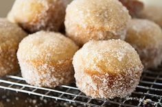 These applesauce donut muffins are baked in a mini muffin tin and then dunked in butter and rolled in cinnamon and sugar.