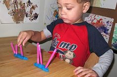Structured task- tall. short and fine motor    It is straws cut at two different lengths. After labeling the straws and looking at them side by side, we created two playdoh worms, one for short straws and the other for tall. This has made sorting a bit more fun for him!