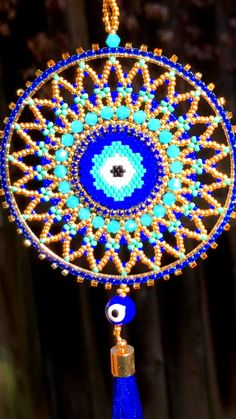 Evil eye protection, Miyuki Delica beadwork, beadweaving, wall decor, beaded evil eye This beautiful evil eye wall hanging is now available at SplendidBeads's Etsy Shop Bead Embroidery Jewelry, Beaded Jewelry Patterns, Beaded Embroidery, Seed Bead Patterns, Beading Patterns, Brick Stitch Earrings, Beads Pictures, Beaded Christmas Ornaments, Etsy Shop