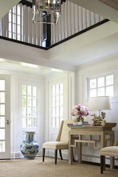 foyer in Nantucket beach house - ♥ Asian inspired console + lamp + very large blue and white urn