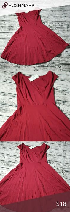 Wine Faux Wrap Top A Line Dress Brand new. Too big. Fits tts. Top is lined in front. Soft comfortable cotton. Color is a wine/maroon coloring. Dresses