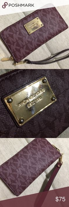Michael Kors Merlot monogram wristlet wallet Practically brand new! It was only used for about a week. So scuffs or marks on Leather itself, only on gold harness from being in my closet. Other than that, it's perfect! I have too many purses and I'm slowly detashing Michael Kors Bags Clutches & Wristlets