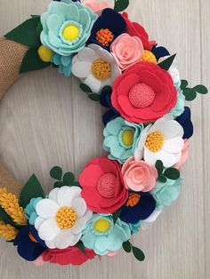 Welcome to my shop! This beautiful colorful wreath is about 33 cm (13 inch) and READY TO SHIP . It has been wrapped with burlap and designed with handmade felt flowers and with too much love and care. To order this size at discounted price please see link given below: