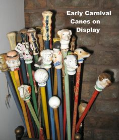 Figural Carnival Canes from the early 1900s. If I had to use a cane, I'd like one of these!