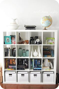 ikea expedit redux, via Flickr. Nice arrangement, I like the globe and the cameras.